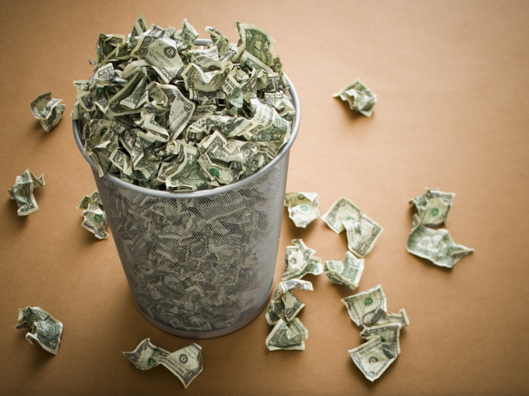 Waste paper basket with crumpled money