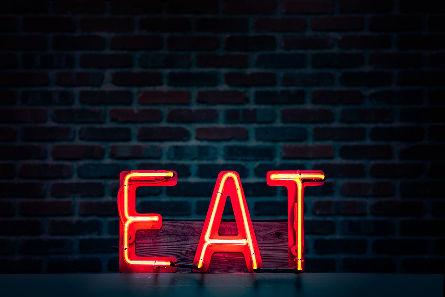 red eat neon sign turned on